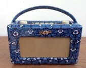 Re-cover Customer's Radio in supplied fabric