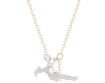 Golden girl on swing silver necklace