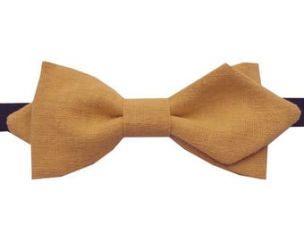 Bow tie yellow ochre with sharp edges