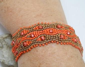 Orange and bronze hand-woven bracelet