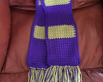 Purple and green fringed crocheted scarf