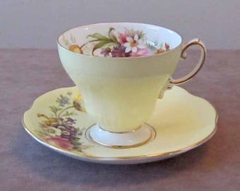 Floral Pale Yellow and Gold Gilt Teacup and Saucer by English Maker Foley Bone China 1950's