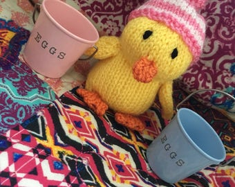 Small Easter knit duckling with striped hat