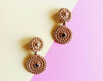 Vintage earrings, dangling chainets spirals, gold colored metal and little black rhinestone clip on 80s