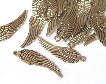 10 large charms/pendants silver tone 30x9mm feather wings