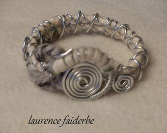 Bangle bracelet is made of aluminum and ecru wool and gray