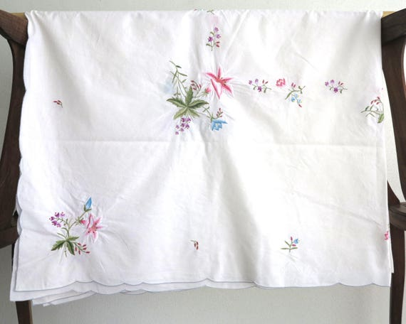 Mid 20th century embroidered rectangular tablecloth with bouquets of multi colored flowers on white linen, 65 x 50 inches / 165 x 127 cm