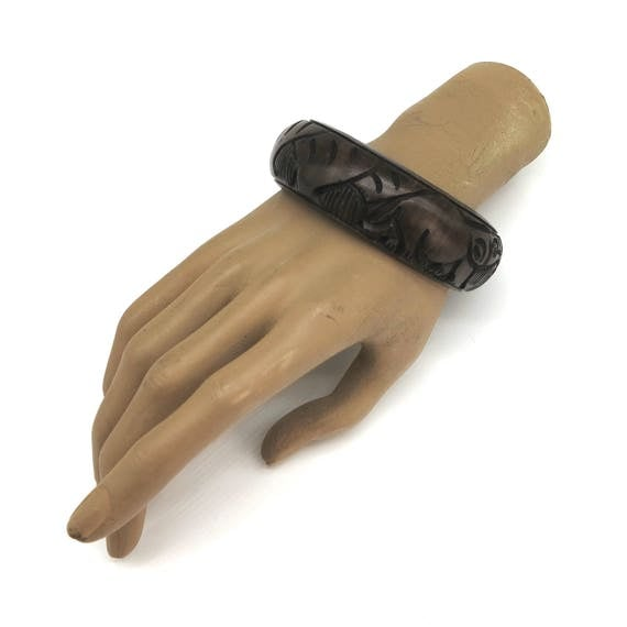 Hand carved African tribal bracelet / bangle with elephant and rhinoceros, dark brown wood, 1 inch / 2.5 cm wide