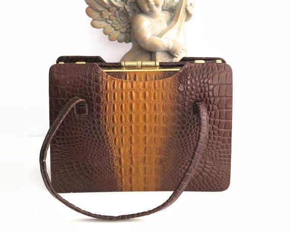 Large vintage faux crocodile handbag in brown and mustard colors, decorative frame and clasp, multiple compartments, 1960s / 70s
