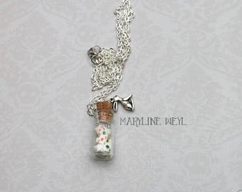 rabbit and card game vial necklace