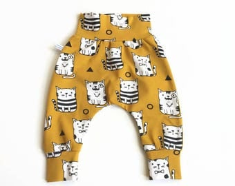 Yellow baby harem pants with cats. Pants with same fabric waistband and cuffs. Comfortable toddler pants. Jersey knit fabric.