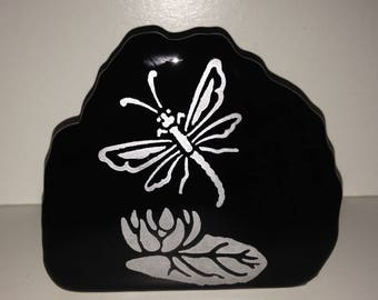 A Dragonfly Paused Over a Water Lily Exclusive Design Etched and Tinted in Silver on a Black Glass Paperweight from Crafts by the Sea
