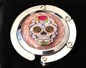 """Case Hanger -  """" Sugar Skull """" image SSR6C6 under glass dome."""