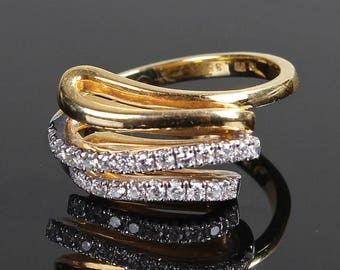 An 18k gold and diamond ring
