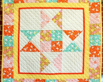Cuckoos Calling quilt for cot, lap or wall.