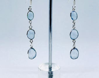 Aquamarine earrings set in sterling silver (92.5). Natural authentic aquamarines. Perfectly matched. Faceted stones. Length- 1.65 inch long.