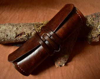 round stiff brown leather sunglasses case