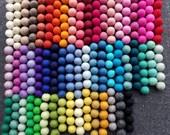 Create your own custom felt ball Garland choose your colors and length. Felt ball party garland