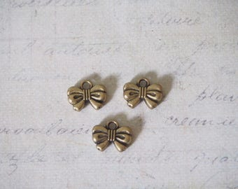 small metal bow 3 charms bronze 12 x 9, 5x3mm
