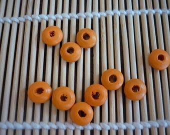 Wood disc orange 10 mm, sold in packs of 10.