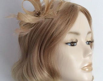 NATURAL FASCINATOR, Made of sinamay, with feathers, Amber rhinestone,on a clip
