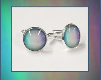 Uranus cufflinks presented in a silver and black box with quality photo card