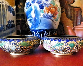 Cloisonne enamel cups with peony flower pattern and foliage on black and turquoise background Asian art