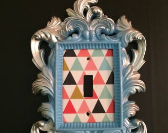 Blue with silver light switch cover, colorful triangles
