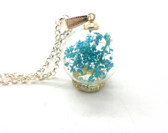 Silver globe, turquoise leaves necklace