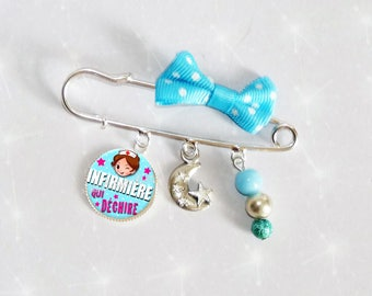 Brooch pin with blue bow sky dot beads nurse tearing