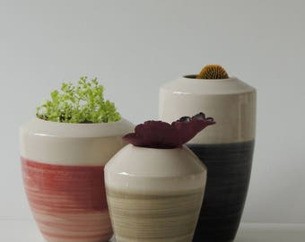three ceramic vases 17-228