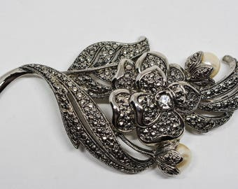 Large silver tone and crystals brooch