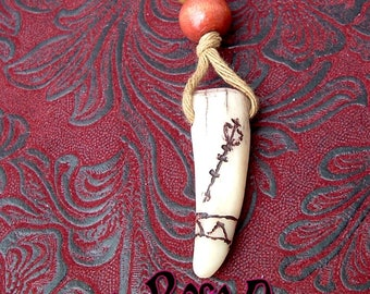 Ventrue carved antler pendant