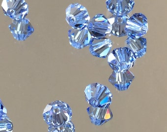 Swarovski Crystals Blue Crystal Beads - Light Sapphire Blue 4mm Bicone Beads  - Package of 24