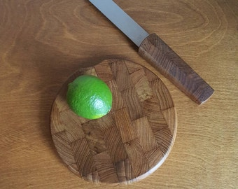 Danish modern Dansk large size staved teak paddle bar cheese cutting board with matching serrated knife Jens Quistgaard design Thailand