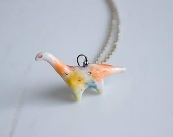 ceramic rainbow brontosaurus totem pendant, porcelain jewelry, dinosaur jewelry, dinosaur necklace, miniature animal, dinosaur totem