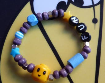 Elastic bracelet child fun various beads in shades of blue-gray head lego yellow polymer clay