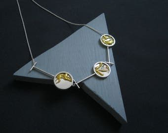 Power of three. Elegant three piece necklace in recycled silver and glass mirror repaired in the kintsugi style.