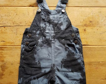Hand-tie-dyed baby dungarees. Black and grey.