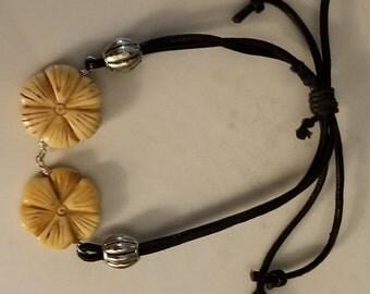Adjustable leather bracelet and bone ornaments