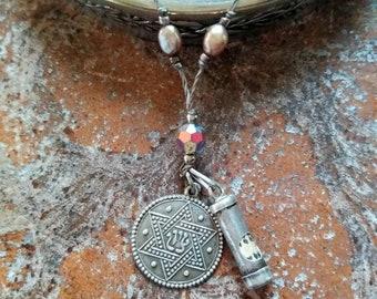 Antique Torah and star of David necklace .