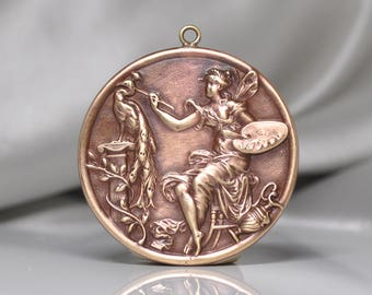 French Artist Fairy Nymph Painting a Peacock Medal Pendant Raw Brass Gold Toned 1 Piece
