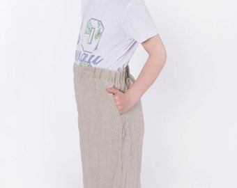 Boys Linen trousers with side pockets and inset rubber belt sides and back