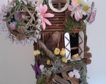 Handmade driftwood and tree bark fairy house.