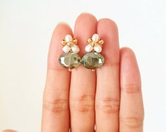 Pearl earrings with a crystal