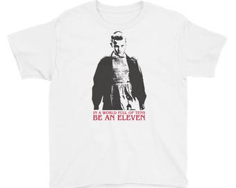 In a world full of tens be an Eleven. Stranger Things Youth T-Shirt