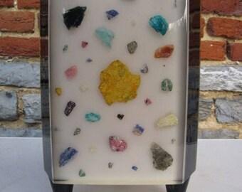 Lamp in plexiglas and semi-precious stones, circa 1960.