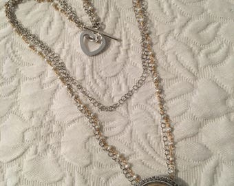 Vintage silver and mother of pearl pendant on multi-strand silver, pearl and gold necklace