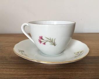 Vintage Porcelain Demitasse Teacup and Saucer with Gold Gilding and Floral Design