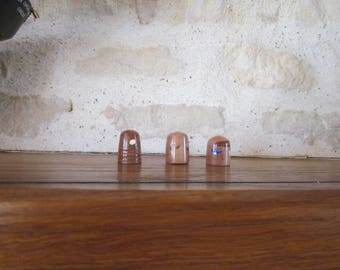 Dice collection or thimble turned in cherry tree